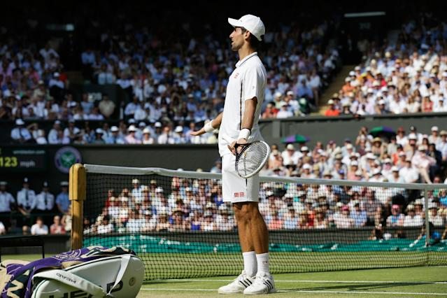 LONDON, ENGLAND - JULY 07: Novak Djokovic of Serbia reacts as he speaks with Chair Umpire Mohamed Lahyani during the Gentlemen's Singles Final match against Andy Murray of Great Britain on day thirteen of the Wimbledon Lawn Tennis Championships at the All England Lawn Tennis and Croquet Club on July 7, 2013 in London, England. (Photo by Anja Niedringhaus - Pool/Getty Images)