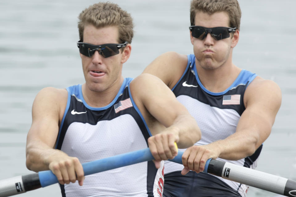 USA's Cameron Winklevoss, left, and twin brother Tyler take the start of their Men's pair repechage at the Beijing 2008 Olympics in Beijing, on 11 August 2008. Photo: Gregory Bull/AP
