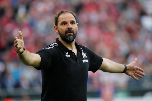 Soccer Football - Bundesliga - FC Cologne v Schalke 04 - RheinEnergieStadion, Cologne, Germany - April 22, 2018 Cologne coach Stefan Ruthenbeck reacts REUTERS/Wolfgang Rattay DFL RULES TO LIMIT THE ONLINE USAGE DURING MATCH TIME TO 15 PICTURES PER GAME. IMAGE SEQUENCES TO SIMULATE VIDEO IS NOT ALLOWED AT ANY TIME. FOR FURTHER QUERIES PLEASE CONTACT DFL DIRECTLY AT + 49 69 650050