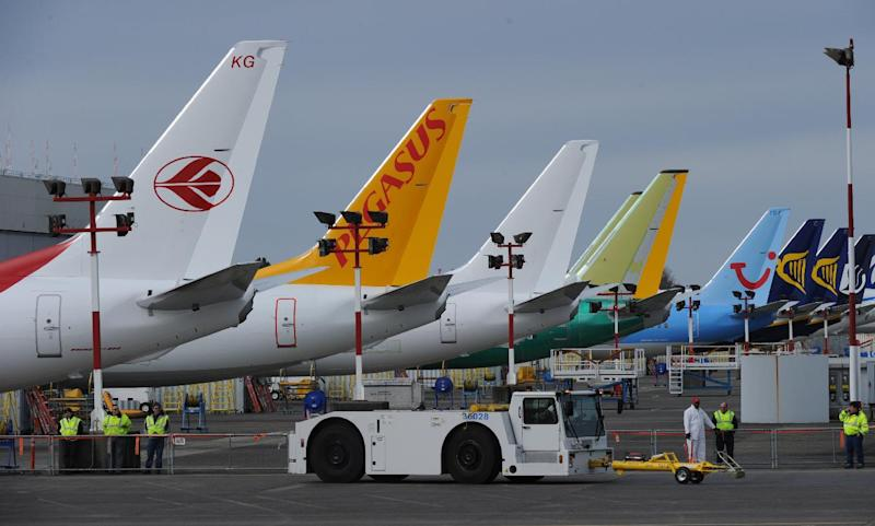 A line of 737-800 aircraft wait for delivery at Boeing Field, Washington state on March 20, 2011 (AFP Photo/Mark Ralston)
