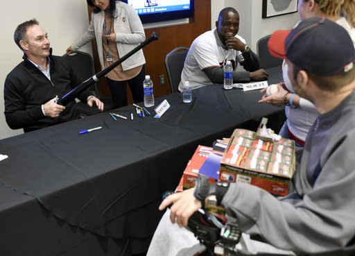 Minnesota Twins manager Paul Molitor, left, and prospect Miguel Sano speak with fans while signing autographs during the baseball team's TwinsFest on Friday, Jan. 23, 2015, in Minneapolis. (AP Photo/Hannah Foslien)