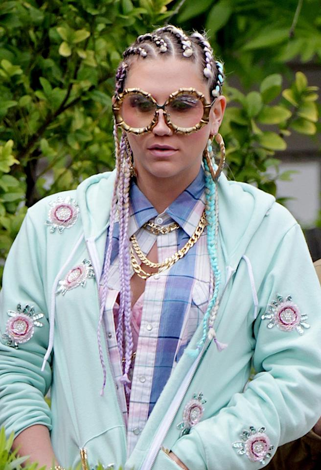 "Thankfully, Ke$ha was spotted sporting this crazy ensemble on the set of her new music video, ""Crazy Kids,"" and not on the red carpet. The eccentric songstress -- known for her flamboyant fashions -- braided her blond locks into multicolored cornrows and accessorized her pastel outfit with layered gold necklaces, gigantic glasses, and doorknocker earrings. What do you make of Ke$ha's ""Crazy Beautiful Life""?"