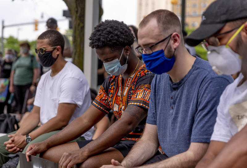 Demonstrators lower their heads for a moment of silence for victims of police brutality on June 4, 2020 in Detroit. (Sylvia Jarrus / for NBC News)