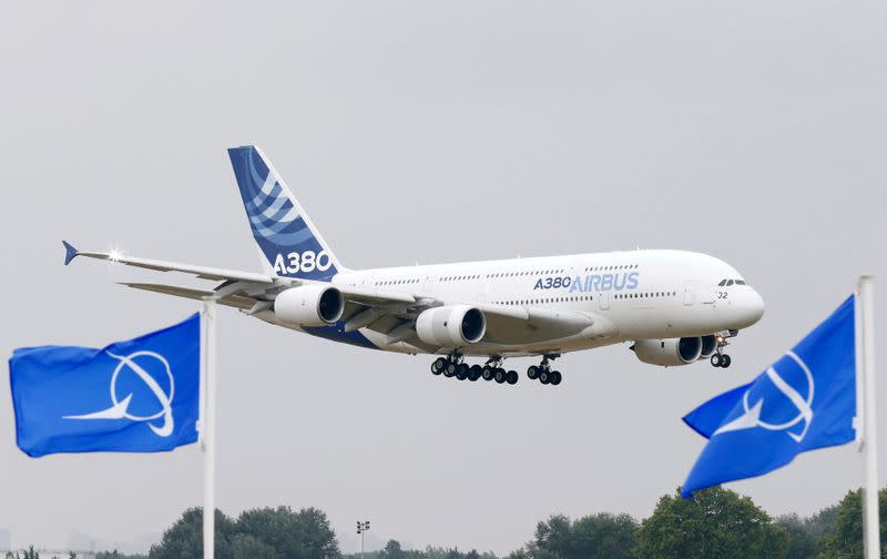 FILE PHOTO: An Airbus A380 flies over Boeing flags at Le Bourget airport near Paris