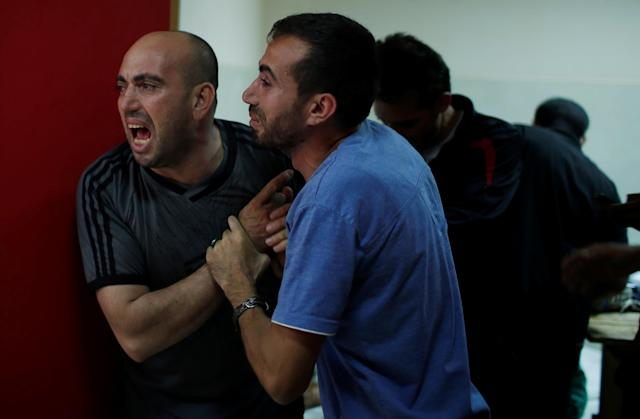 <p>Relatives of a Palestinian, who was killed during a protest at the Israel-Gaza border, react at a hospital in the northern Gaza Strip, May 14, 2018. (Photo: Mohammed Salem/Reuters) </p>