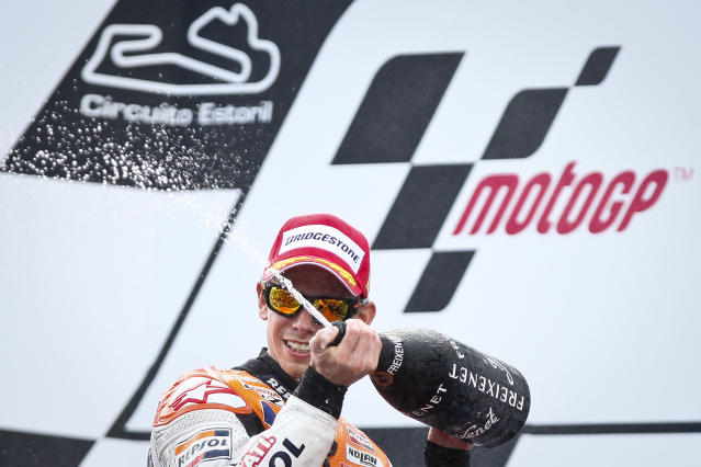 Repsol Honda team's Australian Casey Stoner sprays cava on the podium after winning the Moto GP race of the Portuguese Grand Prix in Estoril, outskirts of Lisbon, on May 6, 2012. Stoner won the race ahead Spain's Jorge Lorenzo and Dani Pedrosa. AFP PHOTO / PATRICIA DE MELO MOREIRAPATRICIA DE MELO MOREIRA/AFP/GettyImages