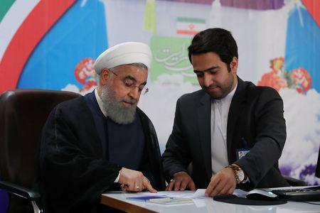 Iran's President Hassan Rouhani registers to run for a second four-year term in the May election, in Tehran