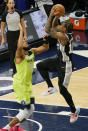 San Antonio Spurs' DeMar DeRozan, right, shoots over Minnesota Timberwolves' Karl-Anthony Towns in the second half of an NBA basketball game Saturday, Jan. 9, 2021, in Minneapolis. (AP Photo/Jim Mone)