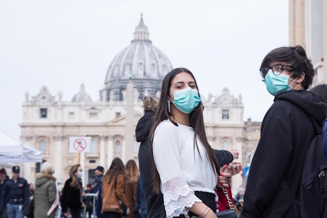 People wear antivirus masks to protect themselves from coronavirus infection in St Peter's Square, Rome (Pacific Press/Sipa USA)