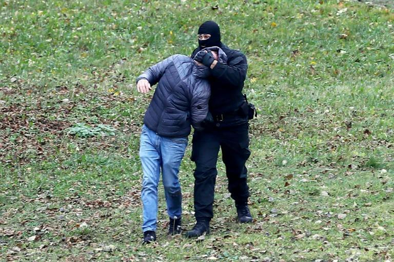 A Belarus protesters is arrested by the security forces during a crackdown on Sunday's demonstrations