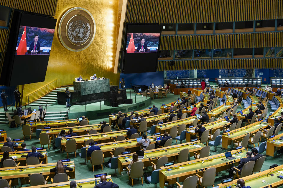 Chinese President Xi Jinping is seen on a video screen as he addresses the 76th Session of the United Nations General Assembly remotely, Tuesday, Sept. 21, 2021 at U.N. headquarters. (AP Photo/Mary Altaffer, Pool)