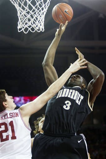 Vanderbilt's Festus Ezeli (3) shoots a layup against Arkansas' Hunter Mickelson (21) during the first half of an NCAA college basketball game in Fayetteville, Ark., Tuesday, Jan. 31, 2012. (AP Photo/Gareth Patterson)