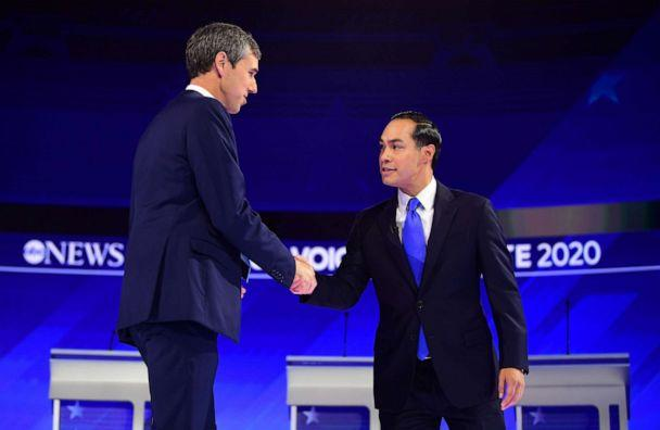 PHOTO: Democratic presidential hopefuls Former Texas Representative Beto O'Rourke and Former housing secretary Julian Castro shake hands as they arrive on stage for the third Democratic primary debate in Houston, Sept. 12, 2019. (Frederic J. Brown/AFP/Getty Images)