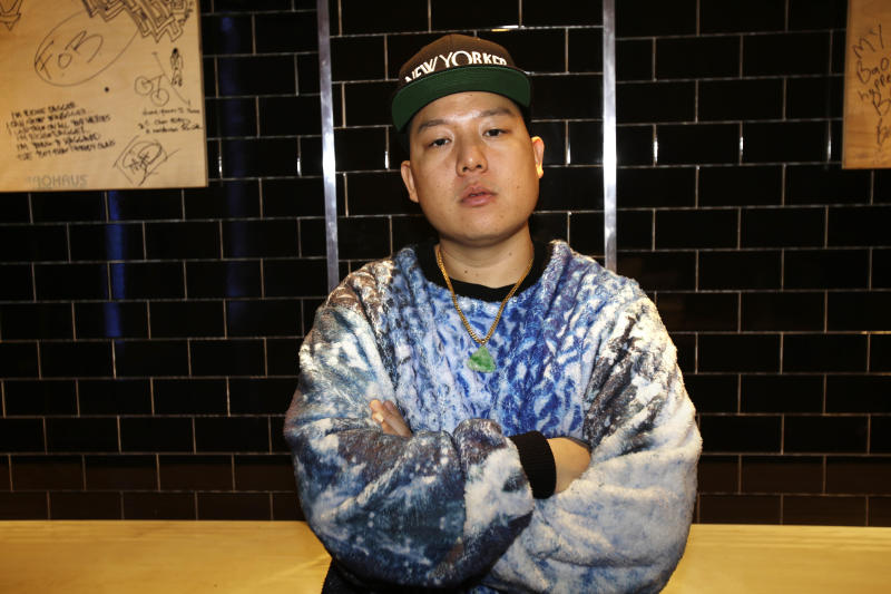 """In this Monday, Jan. 28, 2013 photo, chef Eddie Huang poses for a portrait at his restaurant Baohaus in New York. Huang unveils a biting new memoir, """"Fresh Off the Boat,"""" about race, immigration, and, yes, food. (AP Photo/Seth Wenig)"""