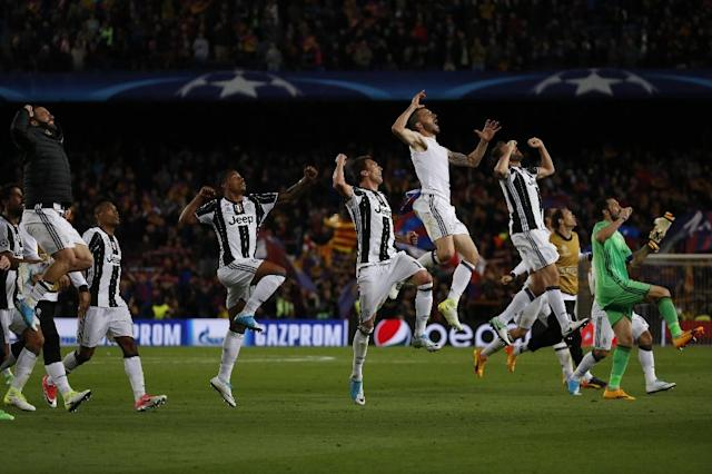 Juventus players celebrate winning after their UEFA Champions League quarter-final second leg match against Barcelona at the Camp Nou stadium in Barcelona on April 19, 2017 (AFP Photo/Marco BERTORELLO)