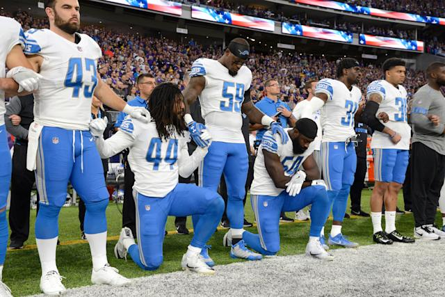 Jalen Reeves-Maybinof the Detroit Lions and teammate Steve Longa take a knee during the national anthem before the game against the Minnesota Vikings on Oct. 1 at U.S. Bank Stadium in Minneapolis, Minnesota.