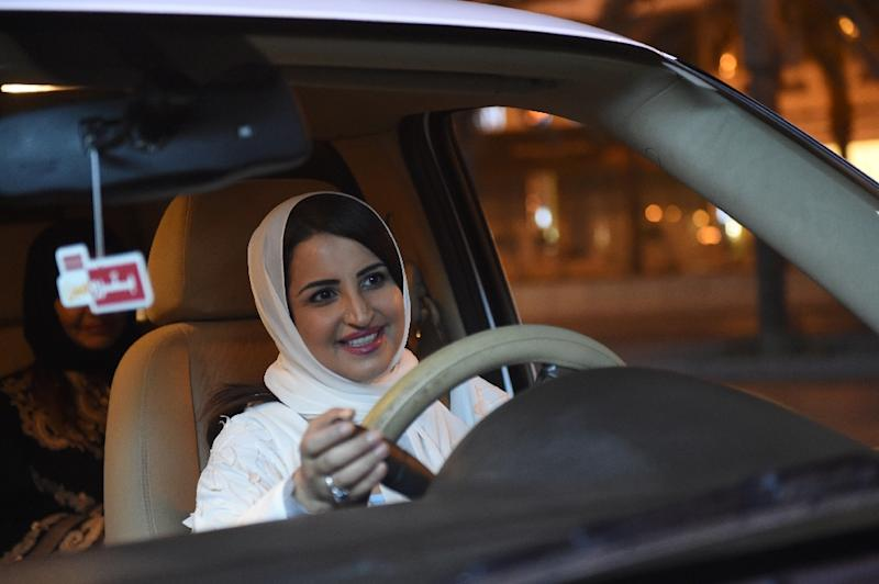Across Riyadh, men and women stopped Samar's white SUV to congratulate her and voice their support (AFP Photo/FAYEZ NURELDINE)