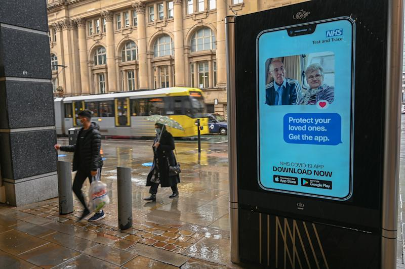 An electronic sign reminds pedestrians to download the NHS Test and Trace app, which has also been heavily criticised (AFP via Getty Images)