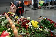 People stand in front of a makeshift memorial at the Boryspil airport outside Kiev (AFP Photo/Sergei SUPINSKY)