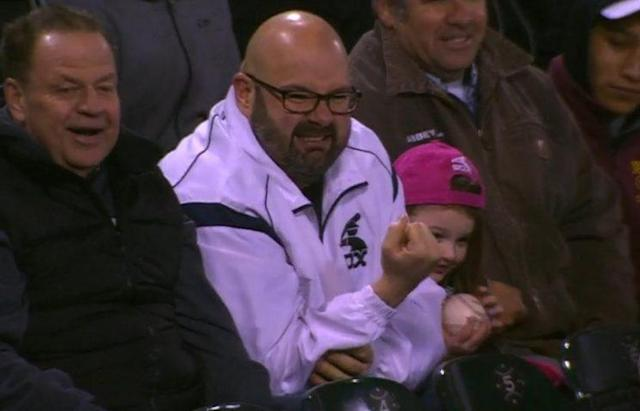 A White Sox fan cringes after being smoked by Miguel Sano's line drive. (MLB.tv)