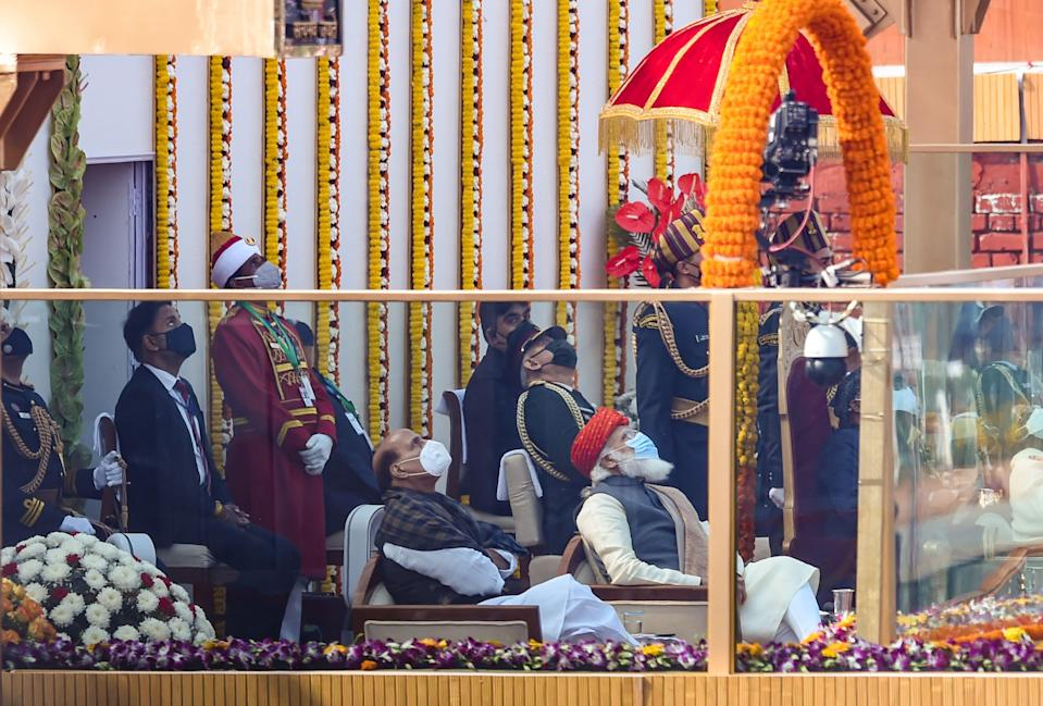 New Delhi: Prime Minister Narendra Modi, Defence Minister Rajnath Singh, Chief of Defence Staff (CDS) Bipin Rawat witness a fly past by Indian Air Force (IAF) aircrafts, during the 72nd Republic Day celebrations at Rajpath, in New Delhi, Tuesday, Jan. 26, 2021.