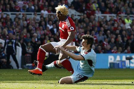 Britain Football Soccer - Middlesbrough v Burnley - Premier League - The Riverside Stadium - 8/4/17 Middlesbrough's Adama Traore in action with Burnley's Joey Barton Action Images via Reuters / Craig Brough Livepic