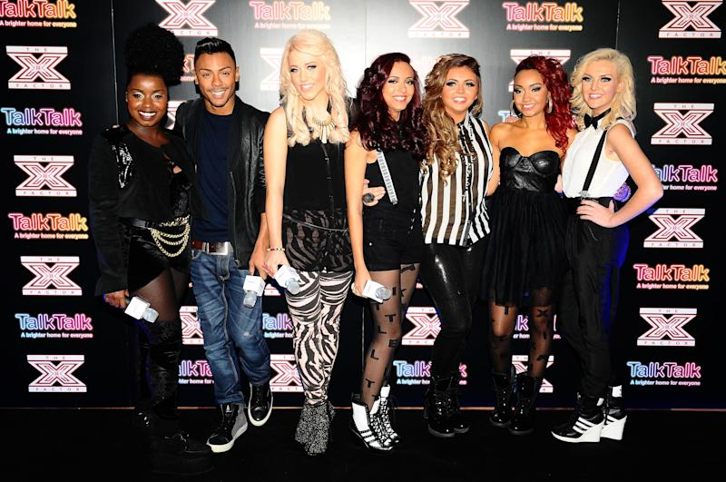 Misha B, Marcus Collins, Amelia Lily and Little Mix at a press conference for the final 4 contestants left in the X Factor, at Talk Talk in London. (Photo by Ian West/PA Images via Getty Images)
