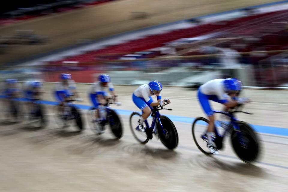 Members of the Italian women's track cycling team round the track during a training session inside the Izu velodrome at the 2020 Summer Olympics, Thursday, July 29, 2021, in Tokyo, Japan. (AP Photo/Christophe Ena)
