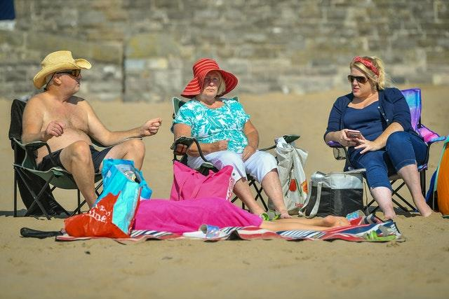 People enjoy the sun at Barry Island