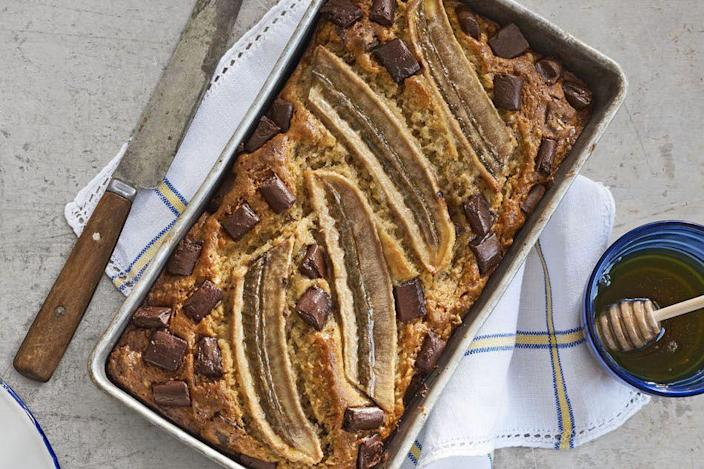 """<p>A bit of Greek yogurt gives this ooey bread some lightness, but it's the roasted banana halves and the giant chunks of chocolate, of course, that make it completely irresistible.</p><p><strong><a href=""""https://www.countryliving.com/food-drinks/recipes/a41637/one-bowl-chocolate-banana-bread-recipe/"""" rel=""""nofollow noopener"""" target=""""_blank"""" data-ylk=""""slk:Get the recipe"""" class=""""link rapid-noclick-resp"""">Get the recipe</a>.</strong></p><p><a class=""""link rapid-noclick-resp"""" href=""""https://www.amazon.com/USA-Pan-1140LF-Bakeware-Aluminized/dp/B0029JQEIC/?tag=syn-yahoo-20&ascsubtag=%5Bartid%7C10050.g.35246097%5Bsrc%7Cyahoo-us"""" rel=""""nofollow noopener"""" target=""""_blank"""" data-ylk=""""slk:SHOP LOAF PANS"""">SHOP LOAF PANS</a><br></p>"""