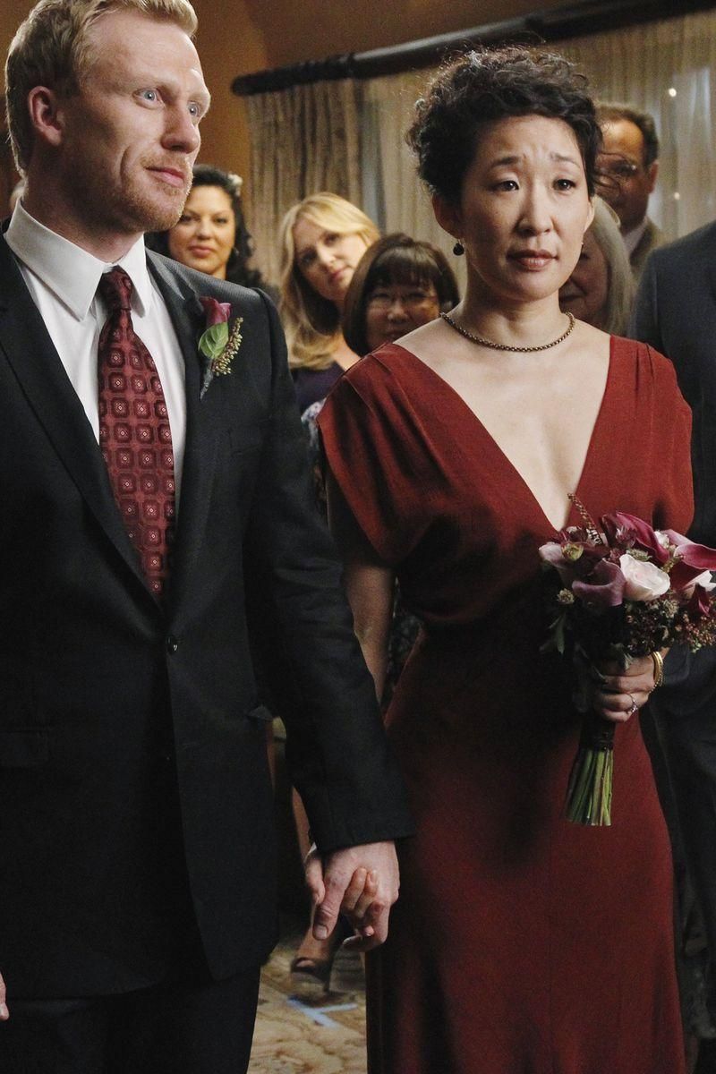 <p>Cristina married fellow doctor Owen Hunt in season 7 of <em>Grey's Anatomy</em> wearing a deep red wedding dress. It featured a plunging V neckline and perfectly matched her bouquet. </p>