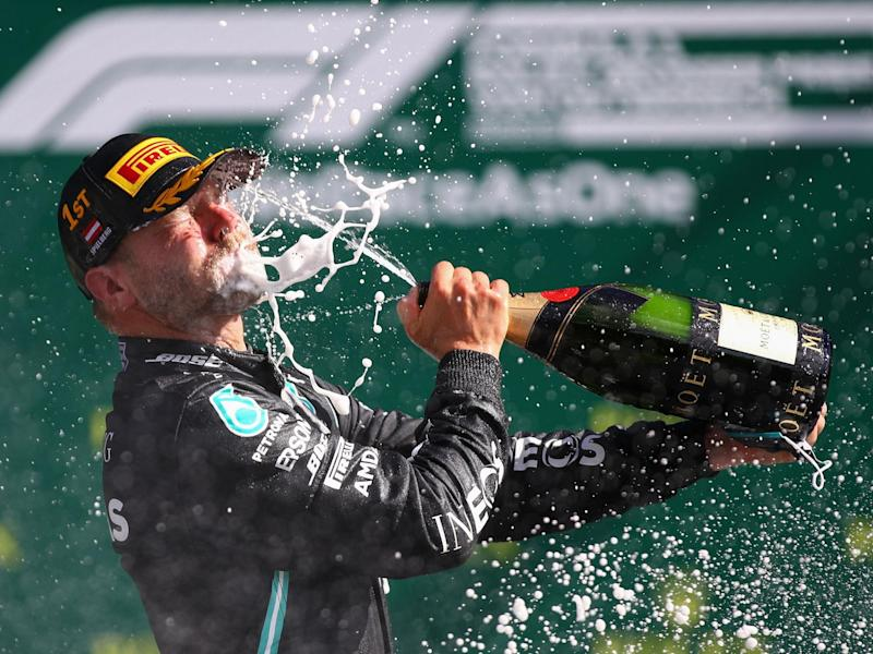 Mercedes' Finnish driver Valtteri Bottas celebrates with champagne: POOL/AFP via Getty Images