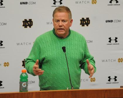 Notre Dame football coach Brian Kelly addresses the media at the beginning of spring football practice Tuesday, March 17, 2014 in South Bend, Ind. (AP Photo/Joe Raymond)