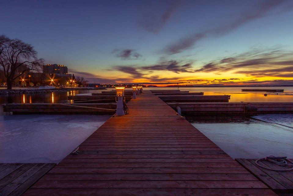 """<span class=""""caption"""">A picturesque image of the Kingston, Ont. waterfront at sunset. </span> <span class=""""attribution""""><span class=""""source"""">(Evi T/Unsplash)</span></span>"""