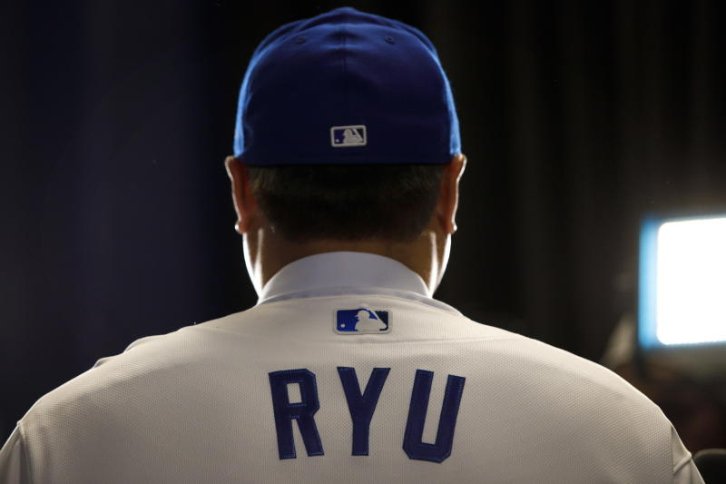 Toronto Blue Jays newly signed pitcher Hyun-Jin Ryu speaks to media while wearing his Blue Jays uniform for the first time at a newss conference announcing his signing to the team in Toronto, Friday, Dec. 27, 2019. (Cole Burston/The Canadian Press via AP)