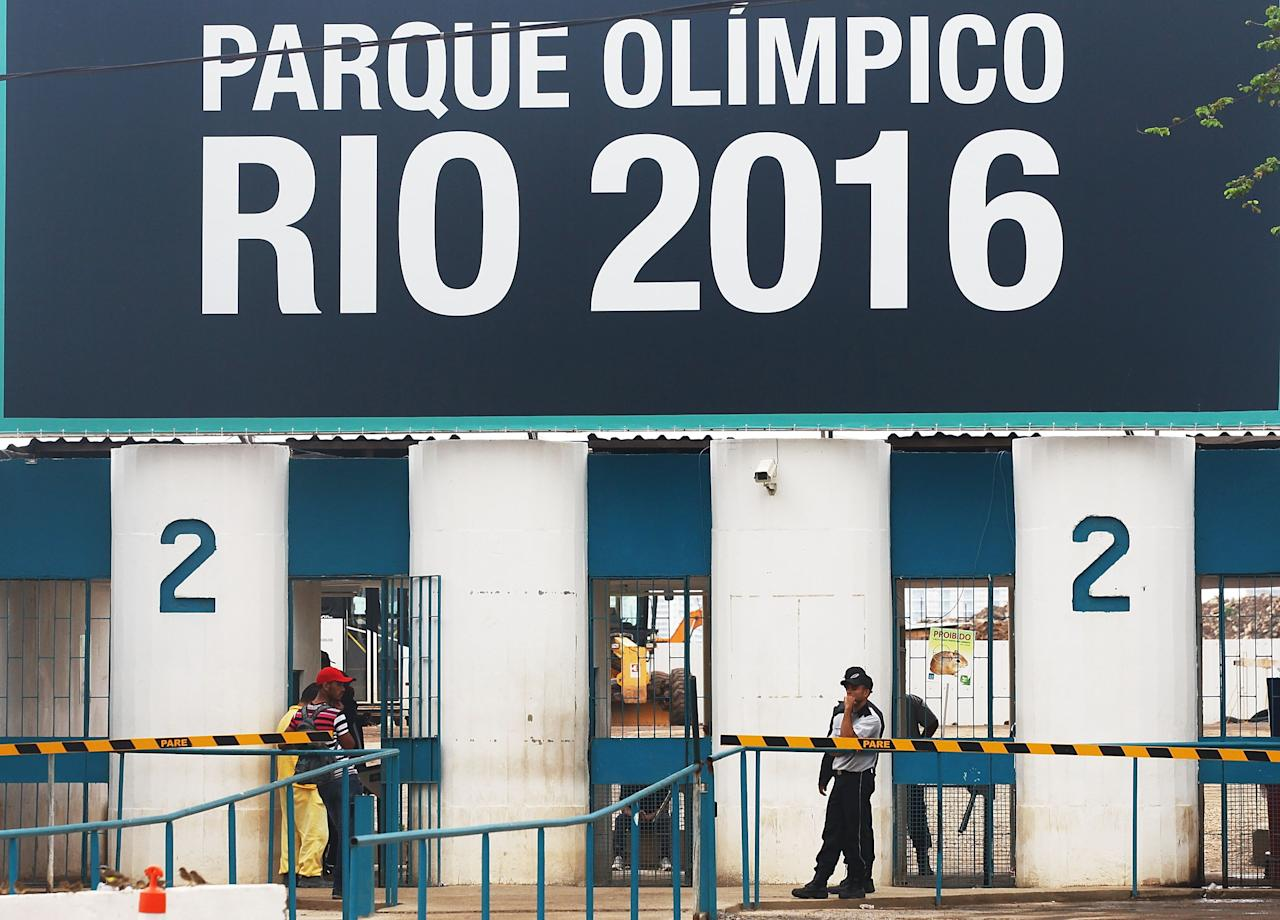 RIO DE JANEIRO, BRAZIL - APRIL 16: A security guard keeps watch at the entrance to Olympic Park, the primary set of venues being built for the Rio 2016 Olympic Games, on April 16, 2014 in Rio de Janeiro, Brazil. More than 2,000 workers have been on strike at the site for the past two weeks in spite of an apparent new settlement. (Photo by Mario Tama/Getty Images)