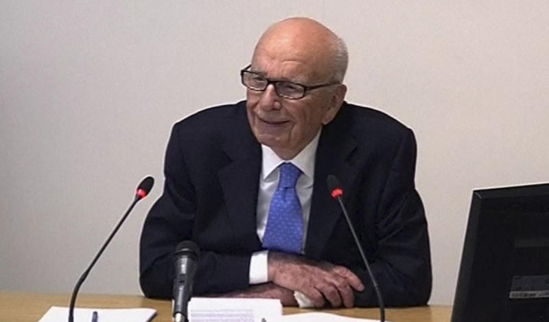 In this image from video, News Corp. chairman Rupert Murdoch appears at Lord Justice Brian Leveson's inquiry in London, Wednesday April 25, 2012 to answer questions under oath about how much he knew about phone hacking at the News of the World tabloid. Murdoch is being grilled on his relationship with British politicians at the country's media ethics inquiry, while a government minister is battling accusations he gave News Corp. privileged access in its bid to take over a major broadcaster. (AP Photo/Pool)