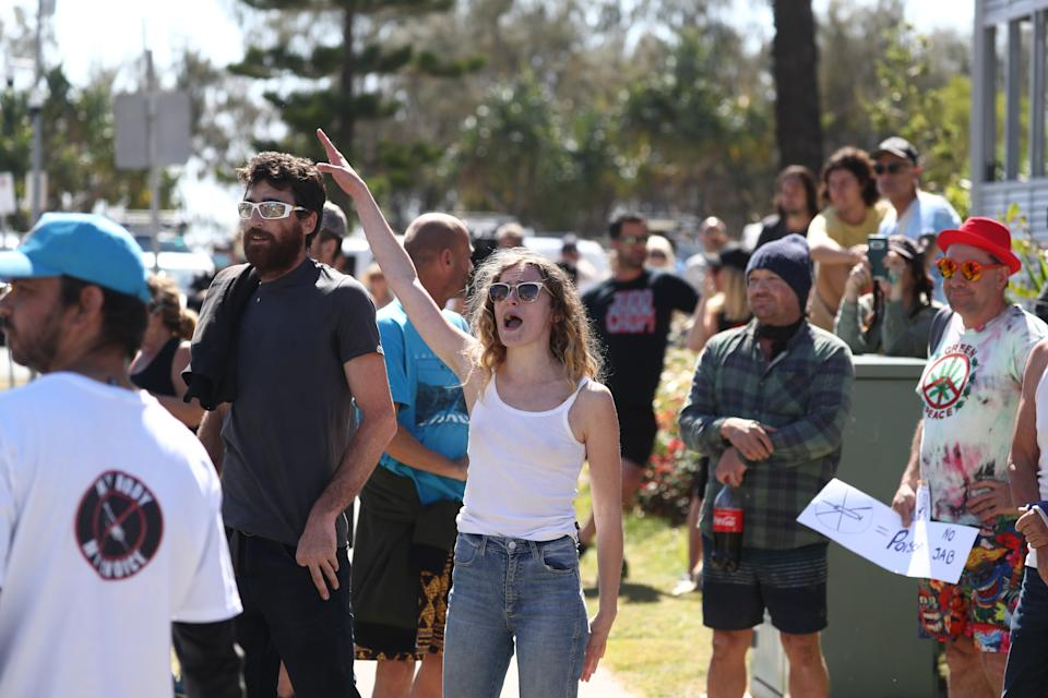 People are seen during an anti-lockdown protest in Coolangatta on Sunday. Source: AAP