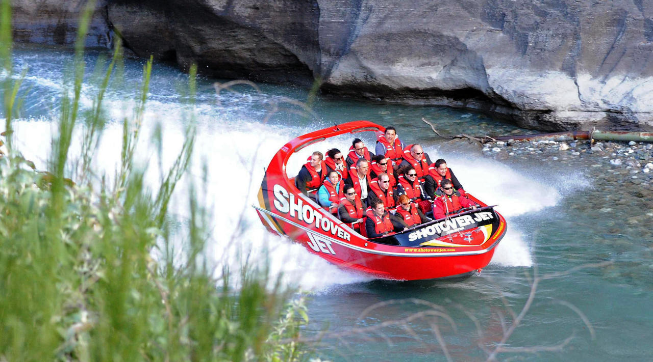 Britain's Prince William, center left, and his wife Kate, Duchess of Cambridge, center right, take a ride on the Shotover Jet boat near Queenstown, New Zealand, Sunday, April 13, 2014. The royal couple are on an official visit to New Zealand. (AP Photo/Craig Baxter, Pool)