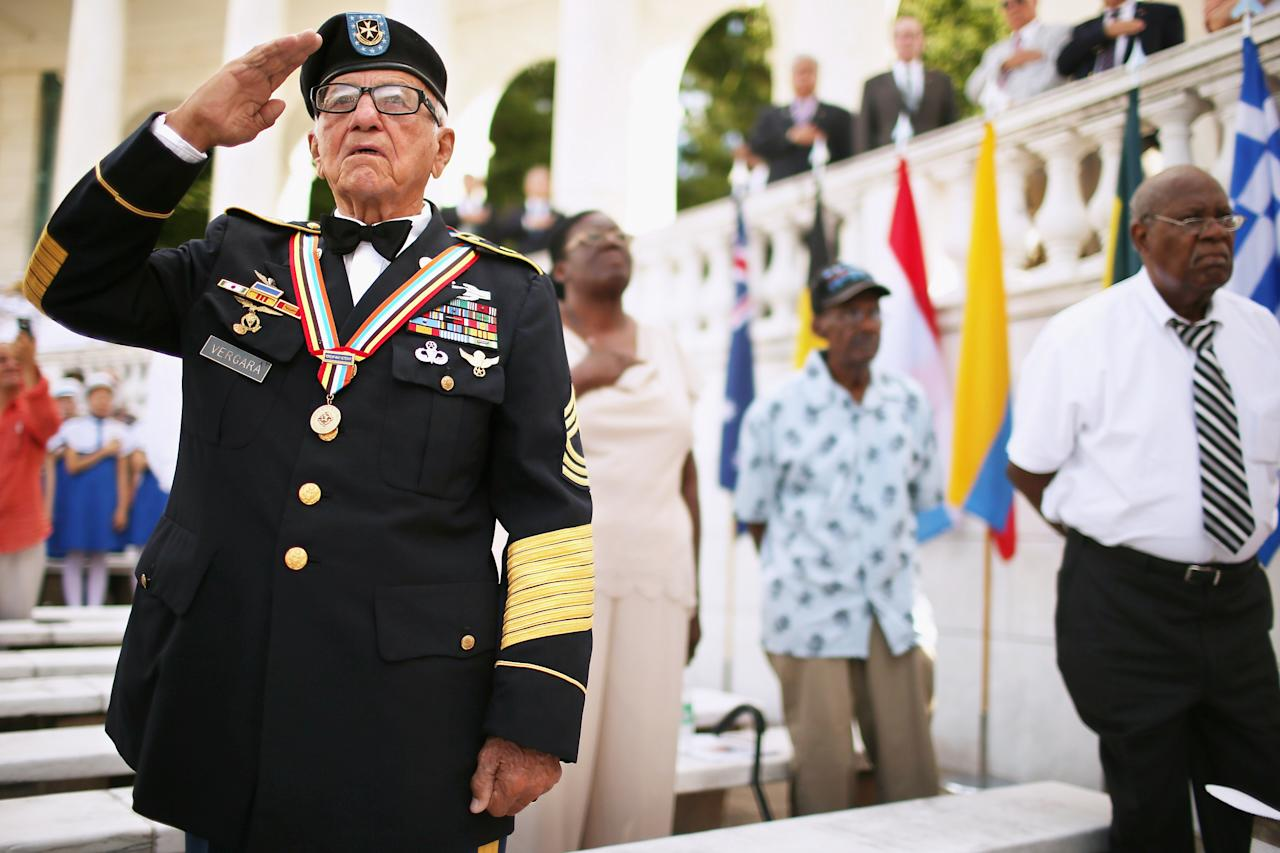 U.S. Army veteran Andres Vergara, 90, of Clearwater, Florida, salutes during the commemoration of the 59th anniversary of the Korean War Armistice at Arlington National Cemetery July 27, 2012 in Arlington, Virginia. With four official combat jumps, paratrooper Vergara recieved the South Korean medal of honor for rescuing 100 children from an orphanage during the war.  (Photo by Chip Somodevilla/Getty Images)
