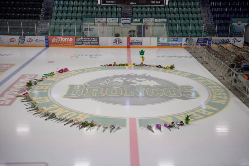 Flowers are shown at center ice as preparations are made at Elgar Petersen Arena for a vigil in Humboldt, Saskatchewan, on Sunday. (Canadian Press/AP)