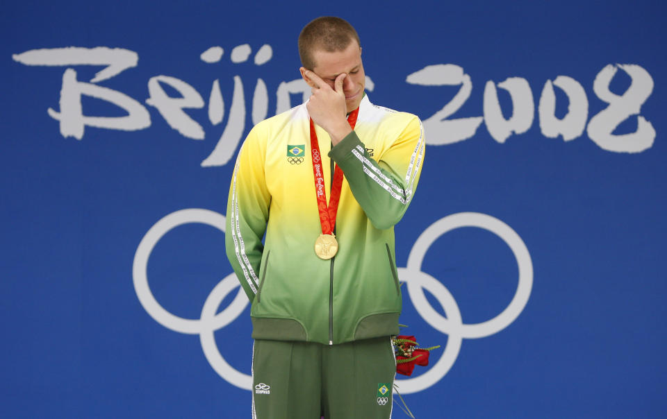 Cesar Cielo of Brazil cries after receiving his gold medal for the men's 50m freestyle swimming final at the National Aquatics Center during the 2008 Beijing Olympics August 16, 2008.     REUTERS/Jerry Lampen (CHINA)