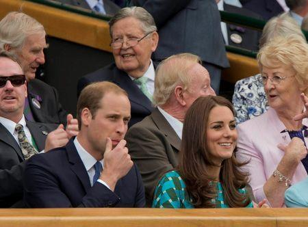 Jul 6, 2014; London, United Kingdom; Prince William the Duke of Cambridge and Kate Middleton the Duchess of Cambridge in attendance for the match between Novak Djokovic (SRB) and Roger Federer (SUI) on day 13 of the 2014 Wimbledon Championships at the All England Lawn and Tennis Club. Mandatory Credit: Susan Mullane-USA TODAY Sports