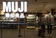Mannequins stand inside a Muji store at a shopping mall in Beijing