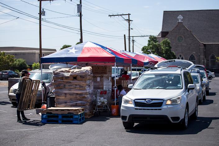 Residents in vehicles wait in line to receive food at a Kelly Center for Hunger Relief distribution site at a church in El Paso, Texas, U.S., on Friday, July, 17, 2020. (Photographer: Joel Angel Juarez/Bloomberg via Getty Images)