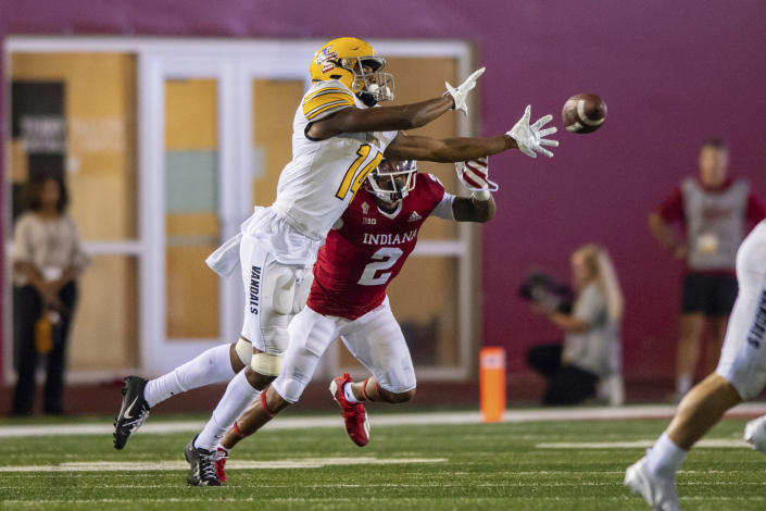 Idaho wide receiver Kyrin Beachem (14) attempts to make a catch while being covered by Indiana defensive back Reese Taylor (2) during the second half of an NCAA college football game Saturday, Sept. 11, 2021, in Bloomington, Ind. (AP Photo/Doug McSchooler)