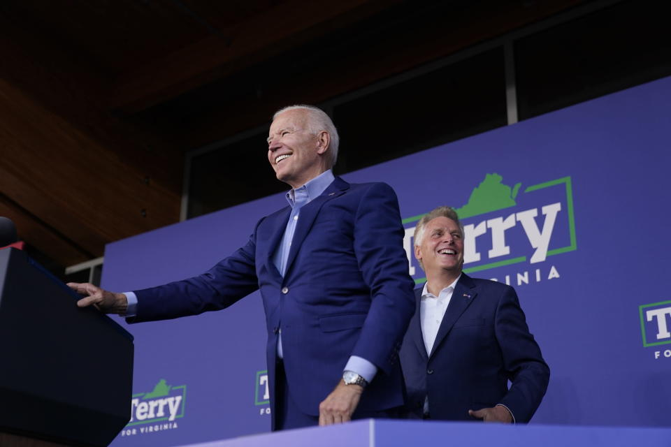 President Joe Biden arrives to speak at a campaign event for Virginia democratic gubernatorial candidate Terry McAuliffe, right, at Lubber Run Park, Friday, July 23, 2021, in Arlington, Va. (AP Photo/Andrew Harnik)