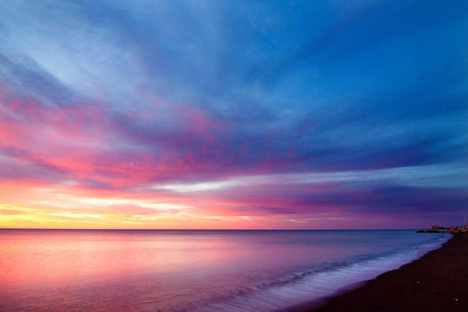 Sunset with pink, yellow, blue and orange colours