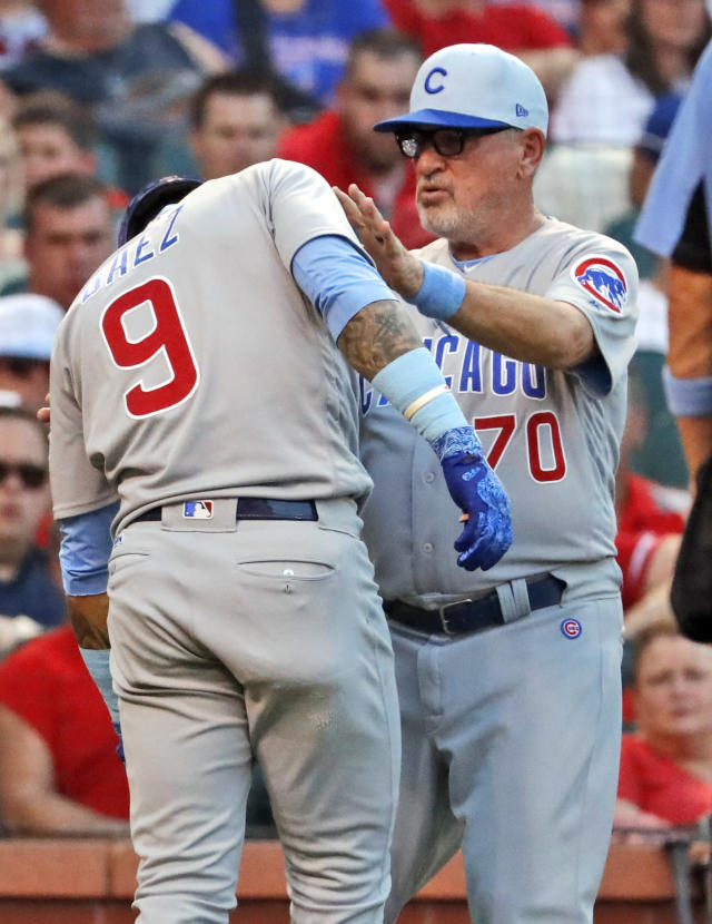 Chicago Cubs' Javier Baez (9) is checked on by manager Joe Maddon after being hit by a pitch during the third inning of a baseball game against the St. Louis Cardinals Sunday, June 17, 2018, in St. Louis. Baez left the game. (AP Photo/Jeff Roberson)