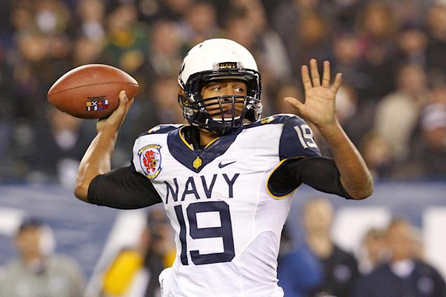 PHILADELPHIA - DECEMBER 8: Keenan Reynolds #19 of the Navy Midshipmen throws a pass during a game against the Army Black Knights on December 8, 2012 at Lincoln Financial Field in Philadelphia, Pennsylvania. The Navy won 17-13. (Photo by Hunter Martin/Getty Images)